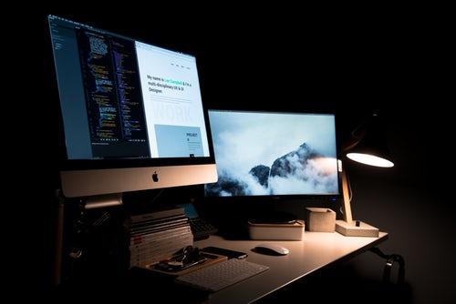 Sleek web design on two mac screens in digital marketing company Glasgow